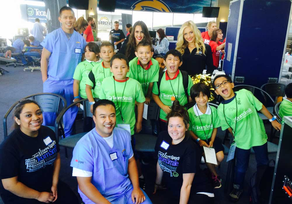 slide show image community outreach san diego dental studio chargers group